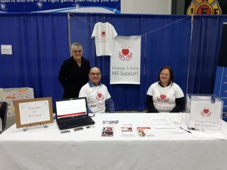 Wendy Decaire, Ron Decaire and Tammy Kuhn at the booth at the Home and Life Expo